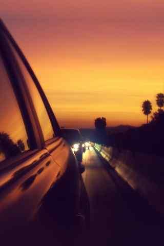 汽车堵在夕阳下小米手机壁纸